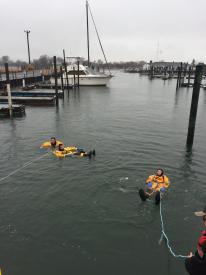 Victim being pulled to dock