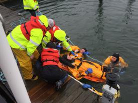 Victim is lifted to dock