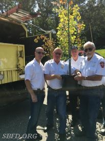 Stony Brook Fire Department receives their tree.